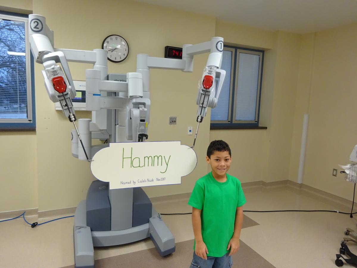 Caleb Nash, a Geneseo student, submitted the winning name in the 'Name the Robot' contest hosted by the Hammond-Henry Hospital surgical department.  Nash named the department's da Vinci® robotic surgical system, 'Hammy'.